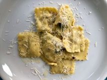 Plate of ravioli with parmesan cheese royalty free stock image