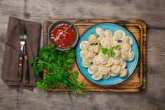 Plate with ravioli on the wooden board. Close up Stock Photography