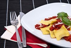 Plate with Raviolis on black Stock Images