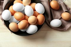 Plate with raw eggs. On kitchen table Stock Image