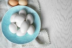 Plate with raw eggs on   table. Plate with raw eggs on kitchen table Stock Photos