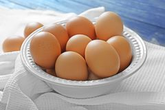 Plate with raw eggs. On tablecloth Stock Photos