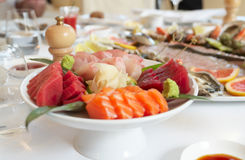 Plate with raw fish pieces. Ginger and wasabi Royalty Free Stock Photo