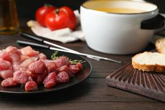 Plate with raw meat fondue pieces on table. Closeup royalty free stock photos