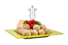 Plate With Raw Meatballs. Cherry tomatoes and parsley isolated on white background Stock Images