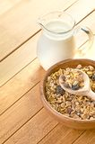 Plate with raw oatmeal on wooden table. Royalty Free Stock Photos