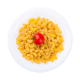 Plate of raw pasta with tomato isolated on white Stock Images
