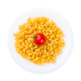 Plate of raw pasta with tomato isolated on white Royalty Free Stock Photo