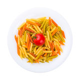 Plate of raw pasta with tomato isolated on white Stock Image