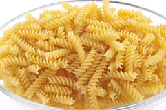 Plate of raw spirelli Stock Images