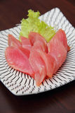 A plate of raw tuna. Sliced and served with vegetable Royalty Free Stock Images