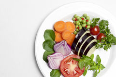 Plate of Raw Vegetables. A white plate of raw and fresh vegetables Stock Images