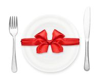 Plate with red bow, fork and knife Stock Photos