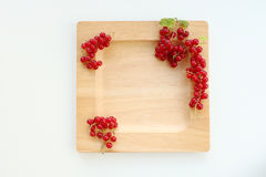 Plate with red currant Stock Photography