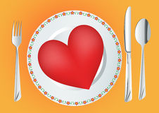 Plate with red heart. Decorated plate, knife, fork and spoon with red heart Stock Photos