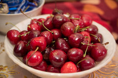 A plate of red ripe cherries bright colors, summer Stock Image