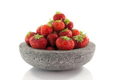 Plate with red strawberries Stock Images