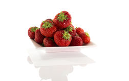 Plate with red strawberries Stock Photos