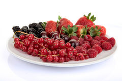 Plate of red summer fruits and berries Stock Photography