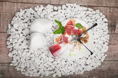A plate with remains of food and inverted glass on a white stones background. Cutlery. Copy space. Royalty Free Stock Photography