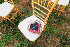 Plate Reserved on the chair at the wedding Royalty Free Stock Images