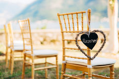 Plate Reserved on the chair at the wedding stock images