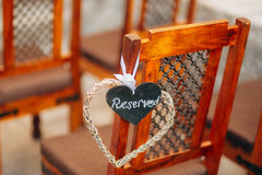 Plate Reserved on the chair at the wedding Royalty Free Stock Photo