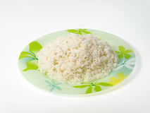 Plate of rice. Cooked cereal prepared in studio Stock Photo