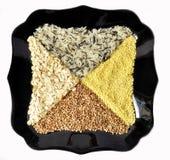 Plate with rice, buckwheat, millet, porridge. Black plate with rice, buckwheat, millet, porridge frome above Stock Photo