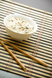 Plate with rice and chopsticks Royalty Free Stock Images