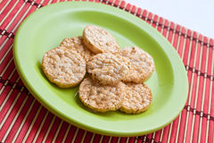 Plate with rice crackers. Royalty Free Stock Images