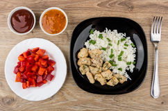 Plate with rice and fried chicken meat, sweet pepper, sauces Royalty Free Stock Photography