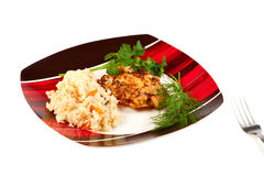 Plate with rice and fried steak Stock Images