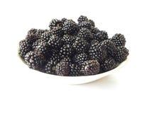 Plate of ripe blackberries. Royalty Free Stock Images