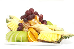 Plate of ripe fruit. A plate of ripe fruit on a white background Royalty Free Stock Image