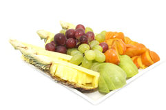 Plate of ripe fruit. A plate of ripe fruit on a white background Royalty Free Stock Photos