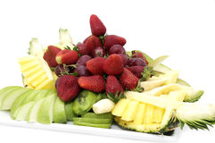 Plate of ripe fruit. A plate of ripe fruit on a white background Stock Photography