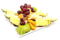 Plate of ripe fruit. A plate of ripe fruit on a white background Stock Images