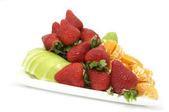 Plate of ripe fruit. A plate of ripe fruit on a white background Stock Photo