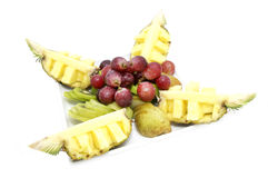Plate of ripe fruit. A plate of ripe fruit on a white background Royalty Free Stock Images