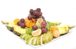 A plate of ripe fruit. On a white background Royalty Free Stock Photo