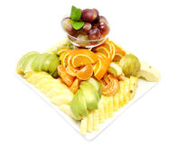 A plate of ripe fruit. On a white background Royalty Free Stock Photos