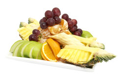 A plate of ripe fruit. On a white background Royalty Free Stock Image