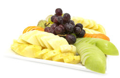 A plate of ripe fruit. On a white background Stock Image