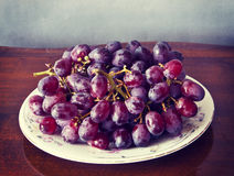 Plate of ripe grapes Royalty Free Stock Image