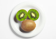 Plate with ripe kiwi fruit Royalty Free Stock Image