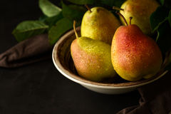 Plate with ripe pears and apples Royalty Free Stock Photo