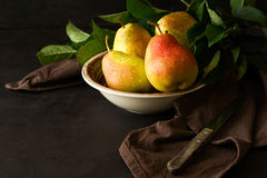 Plate with ripe pears and apples Royalty Free Stock Image