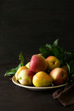 Plate with ripe pears and apples Stock Photography