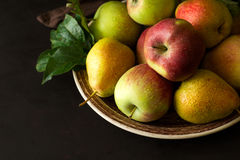 Plate with ripe pears and apples Stock Images